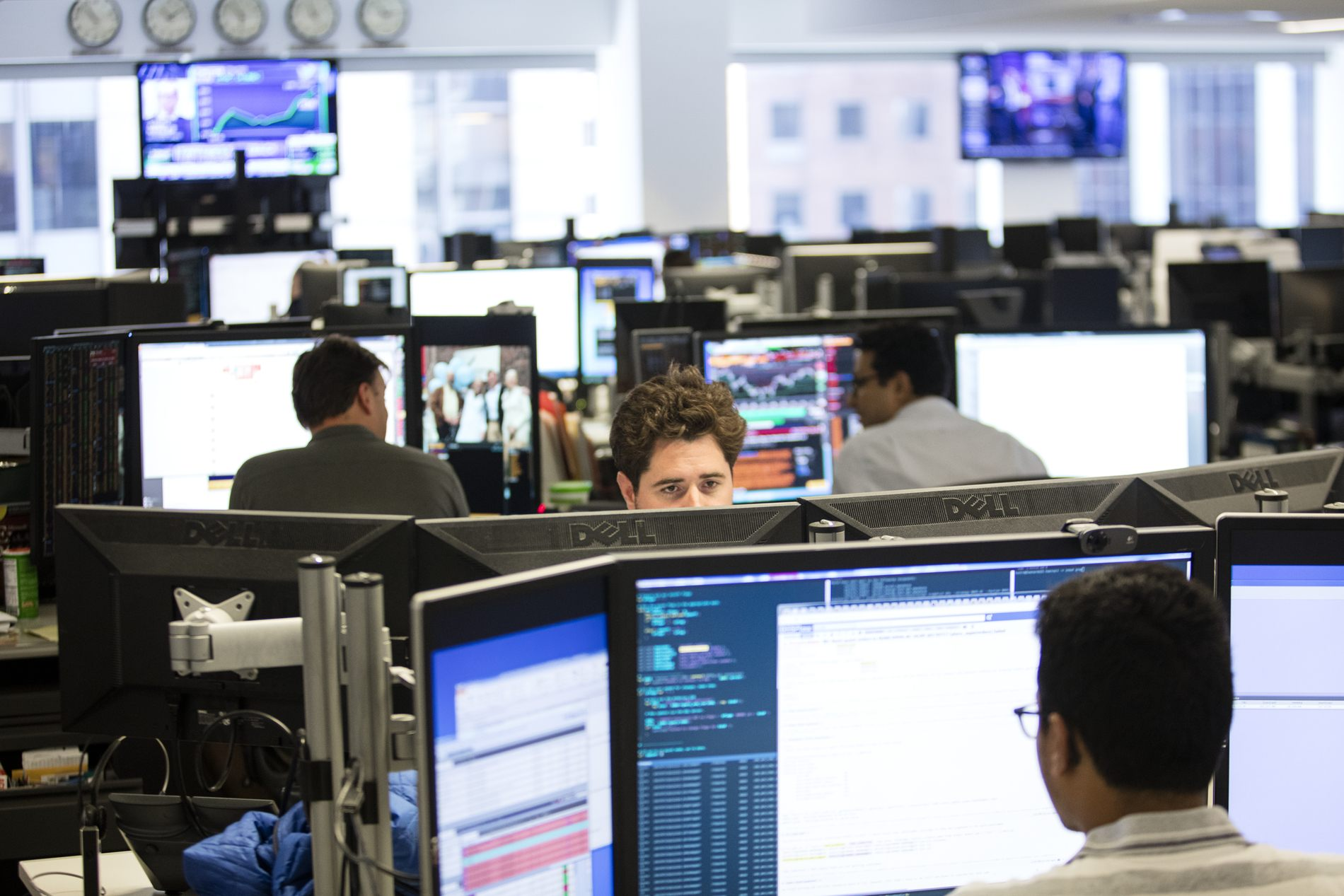 View of trading floor with several rows of workstations.